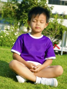 Young-boy-meditating-small-215x285